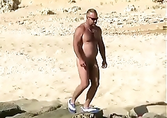 Spying mature with a big cock on the beach
