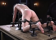 Busty babe in metal device feet tormented