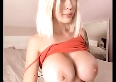 Blonde bitch play with her huge white tits