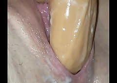 Creamy pussy taking huge dildo