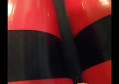 Shiny red latex rubber stockings closeup