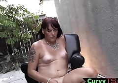 Cute curvy shemale mauls her dick outdoors