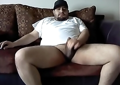 BehrGuy jerks off in the middle of his living room.